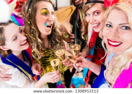 People on party drinking champagne and celebrating birthday or new years eve #1308953113