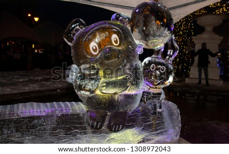 21st international ice sculpture festival in Jelgava Latvia February 2019.Winnie the Pooh and the pig from ice #1308972043