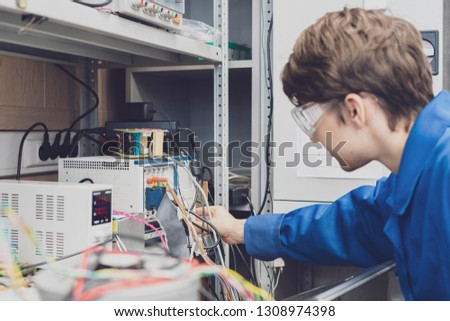 technician or engineer insert cords in power supply #1308974398