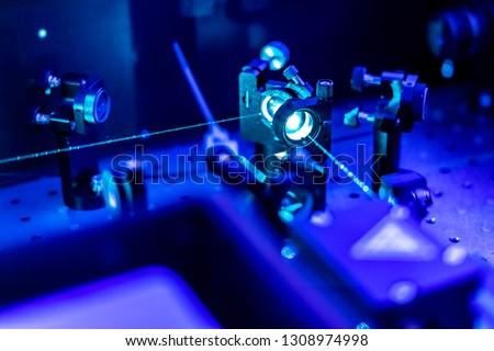 laser reflect on optic table un quantum laboratory #1308974998
