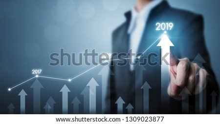 Business development to success and growing growth year 2019 concept, Businessman pointing line dot graph and arrow corporate future growth plan #1309023877