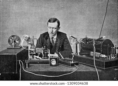 Marconi in front of his receiving device for wireless telegraphy, vintage engraved illustration. From the Universe and Humanity, 1910. #1309034638