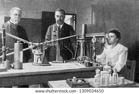 Mr and Mrs Curie in their laboratory, vintage engraved illustration. From the Universe and Humanity, 1910. #1309034650