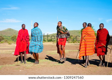 Unidentified Maasai men on Oct 15, 2012 in the Maasai Mara, Kenya. Maasai are a Nilotic ethnic group of semi-nomadic people located in Kenya and northern Tanzania. #1309247560