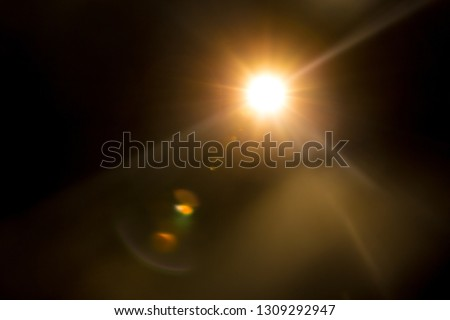 Abstract Natural Sun flare on the black Royalty-Free Stock Photo #1309292947