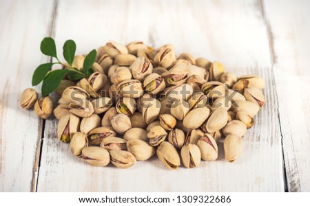 Pistachio nuts in the bowl #1309322686