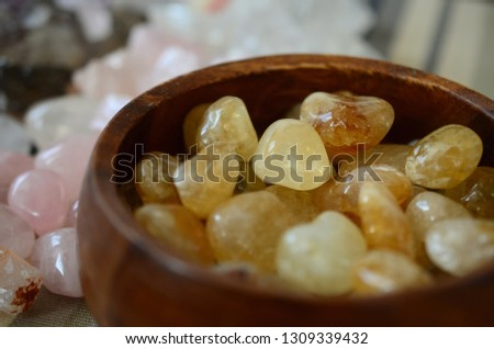 Bowl of Citrine crystals. Tumbled healing crystals citrine. Bowl of crystals, bohemian decor. Happy, bright yellow and gold crystal. Citrine gemmy quality tumbled in wooden bowl. #1309339432