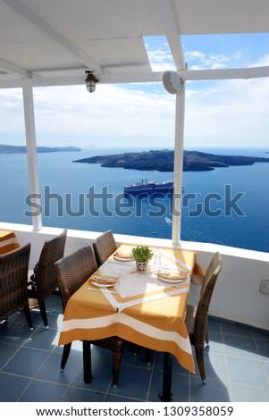 The sea view terrace in restaurant, Santorini island, Greece #1309358059