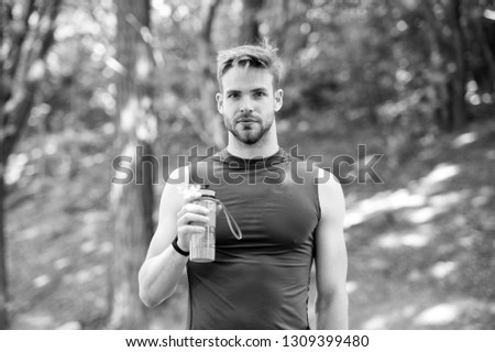 refreshment. refreshment after hart sport workout. man has refreshment with water bottle. refreshment concept and healthy lifestyle. getting refreshed #1309399480