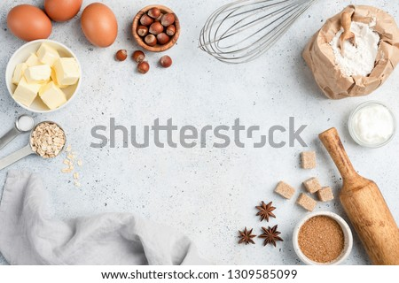 Baking ingredients and utensils on concrete background. Cooking or baking cake, cookies, pastry or bread concept. Top view with copy space for text, recipe, menu #1309585099