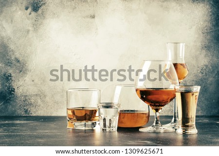 Selection of hard strong alcoholic drinks in big glasses and small shot glass in assortent: vodka, cognac, tequila, brandy and whiskey, grappa, liqueur, vermouth, tincture, rum.  #1309625671