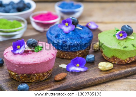 healthy vegan desserts. assortment of raw cashew cakes with matcha, acai, blueberry, mint and nuts. gluten free diet. close up #1309785193