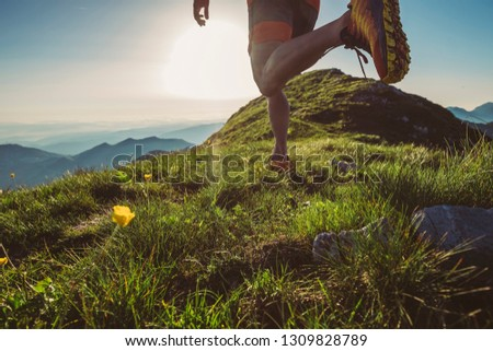 Man trail running on a mountain at the sunrise #1309828789