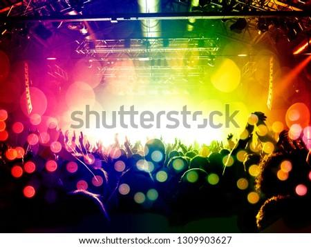 Concert crowd inside a wide arena #1309903627