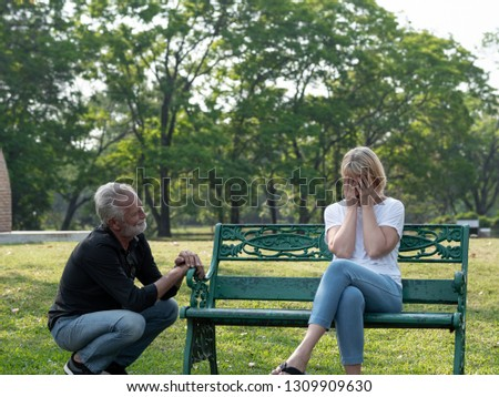 Senior couple having problem, conflict, sadness, do not understand in a park. #1309909630