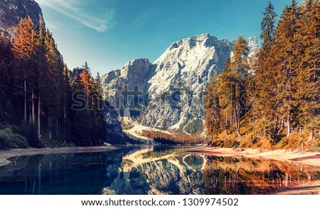 Wonderful Autumn landscape. Braies Lake in Dolomites mountains. Lago di Braies - Best Popular places for Photographers. Majestic Dolomiti rock mountains. Popular travel and hiking place in the nature