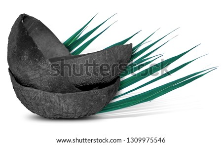 coconut charcoal isolated on white #1309975546