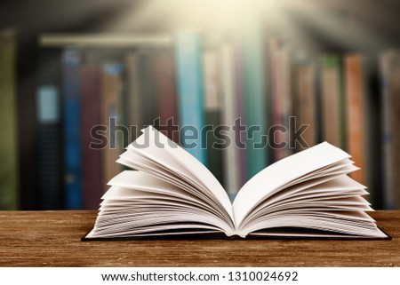 Stack of books in the library and blur bookshelf background #1310024692