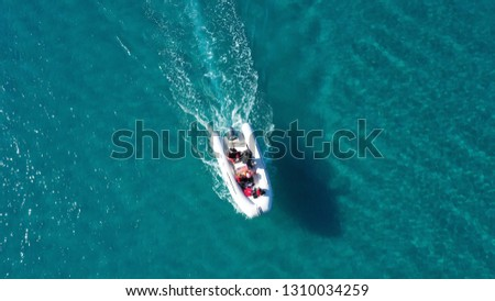 Aerial top view photo of life guard inflatable patroling in exotic bay #1310034259