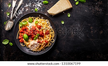 delicious appetizing classic spaghetti pasta with tomato sauce, parmesan cheese and fresh basil, top view #1310067199