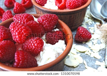 Healthy breakfast or snack with cottage cheese and fresh raspberries. Keto diet. Keto dessert or keto breakfast. #1310070598