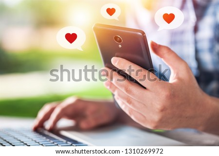Close up hand take smart phone look  message from lovers. Send a message encouraging.      #1310269972