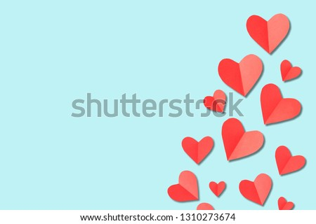 Valentine's Day background. White and red hearts on pastel blue background. Valentines day concept. Flat lay, top view, copy space #1310273674
