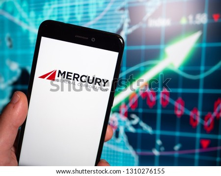 Murcia, Spain; Feb 8, 2019: Mercury General logo in phone with earnings graphic on background. Mercury General is a multiple-line insurance organization #1310276155
