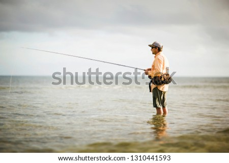 Man fishing at sea #1310441593