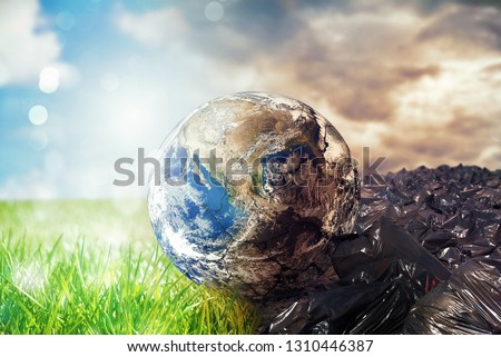 Earth is chancing due to pollution and undifferentiated trash. Save the World. World provided by NASA #1310446387