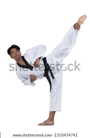 Master Black Belt TaeKwonDo handsome man instructor Teacher fighter show hit pose, studio lighting white background isolated.  White formal fighting suit, motion blur hand foots on taekwondo post. #1310474741
