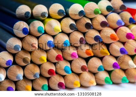 Colored sharpener pencils. Macro shot of many color pencils.  #1310508128