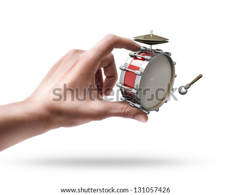 Man's hand holding Bass drum instrument isolated on white background