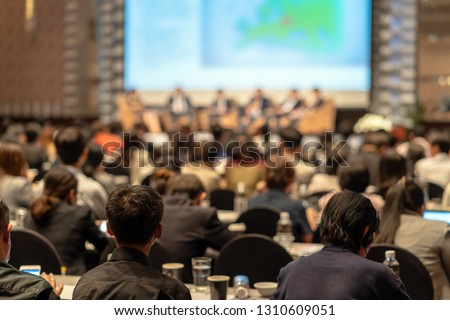 Rear view of Audience listening Speakers on the stage in the conference hall or seminar meeting, business and education about investment concept Royalty-Free Stock Photo #1310609051