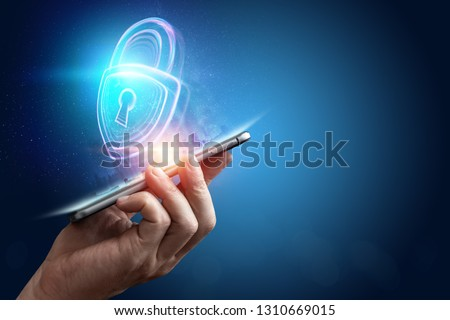 Creative, ultraviolet background, male hand and hologram lock. The concept of security, safe, data privacy, data protection, cryptocurrency, cyber otak. Mixed media. #1310669015