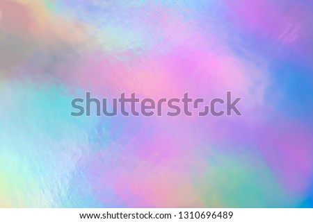 colorful holographic paper with rainbow lights.