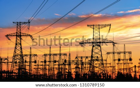 High-voltage  power lines. Electricity distribution station. high voltage electric transmission tower. Distribution electric substation with power lines and transformers. #1310789150
