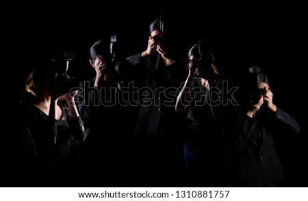 Five Photographers hold camera with external flash point to shoot front, wear normal black suit jacket. studio lighting dark background isolated low exposure, reporter journalist take photo celebrity