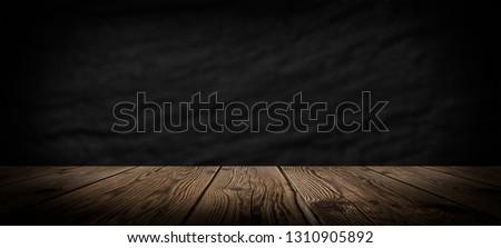 Dark empty room, wooden floor and concrete wall. Dark empty room scene. #1310905892