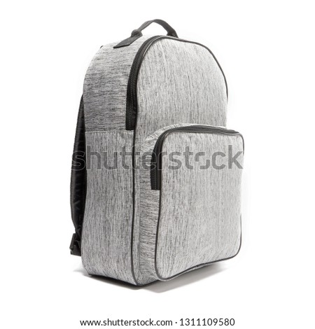 Heather Gray Canvas Backpack Isolated on White Background. Side View of Men's Zippered School Bag with Shoulder Straps and Haul Loop. Traveler Back Pack. Travel Bag for Men. Modern Business Daypack #1311109580