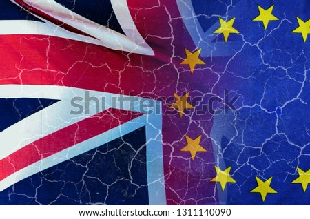 No Deal Brexit concept image of cracks over image of London with UK and EU flags in image #1311140090