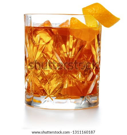 old fashioned cocktail garnished with orange twist isolated #1311160187