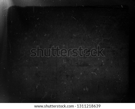 Black grunge scratched background, old film effect, vintage obsolete texture #1311218639