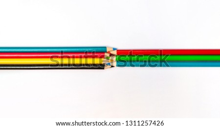 Seven colored pencils. The colors red, green, blue, cyan, magenta, yellow and black. Concept of color profiles converting from RGB to CMYK.