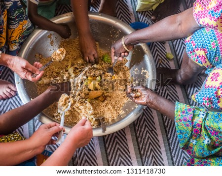 Senegal family eating together in the traditional manner. Senegal. Africa. #1311418730