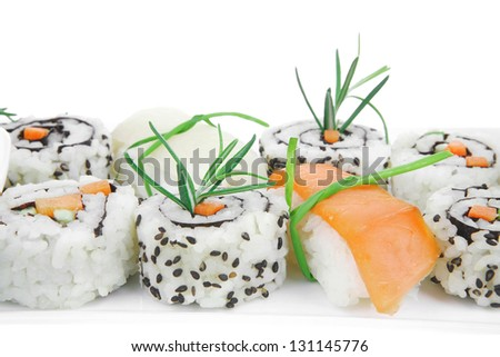 California Roll with Avocado and Salmon, Cream Cheese and Raw Salmon inside. on long white plate . isolated over white background . Maki Sushi and Sashimi #131145776