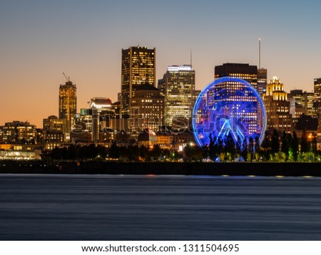 Night view of the Montreal city skyline with St Lawrence river at Quebec, Canada