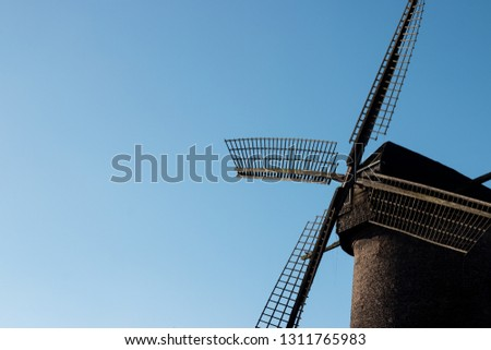 Old windmill in Germany with a beautiful blue sky #1311765983
