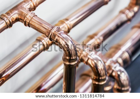 copper pipes and fittings for carrying out plumbing work. Plumbing, fixing pipes and fittings for connection of water or gas systems #1311814784