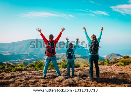 happy mom and dad with son travel in mountains, happy family enjoy hiking #1311918713